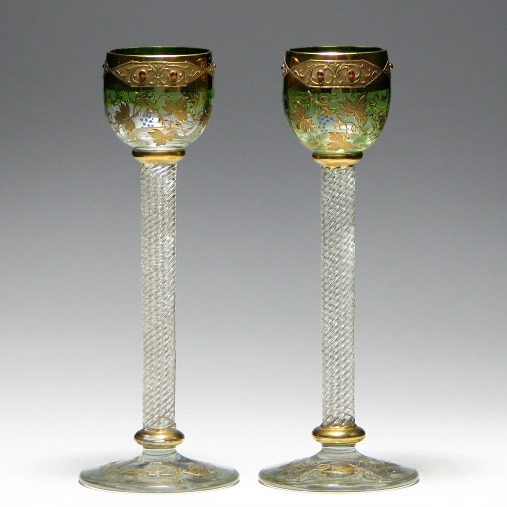 A pair of gilt moser cordial glasses with rope twist stems