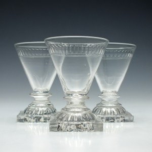 Three George IV Dram Glasses with Lemon Squeezer Feet c1810