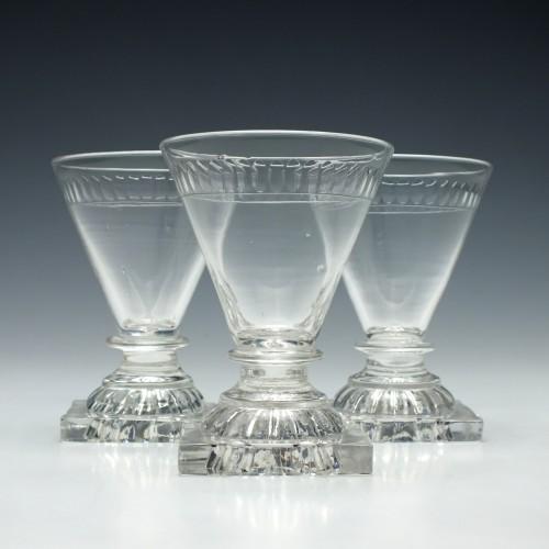 Three George IV Dram Glasses with Lemon Squeezer Feet c1810