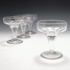 Four Hollow Stem Cut Glass Champagne Coupes c1900