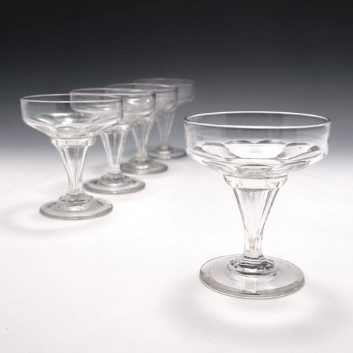 Four Octagonal Hollow Stem Cut Glass Champagne Coupes c1900