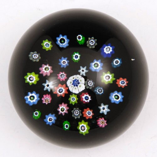 A Whitefriars 1982 Spaced Paperweight on Black Ground with Monk Cane
