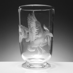 A Vase Engraved With Geese in Flight