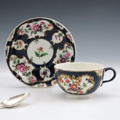 A Worcester First Period Porcelain Scale Blue Tea Cup and Saucer c1765