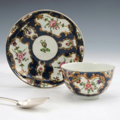 A Worcester First Period Porcelain Scale Blue Tea bowl and Saucer c1765