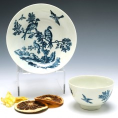 A Worcester Porcelain The Birds in Branches Tea Bowl and Saucer c1780