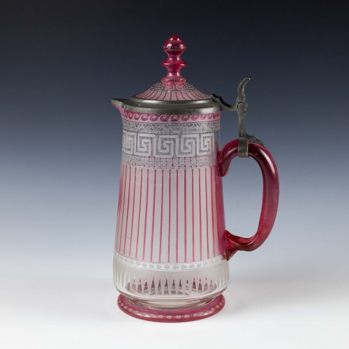 A Bohemian Red Flashed Highly Engraved Greek Key Glass Jug c1880