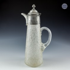A Glass and Polished Pewter Claret Jug c1890