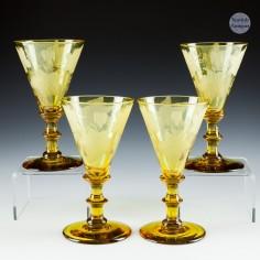 Four Engraved Amber Wine Glasses c1910