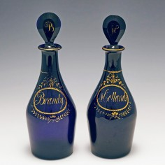 Two Early 19th Century Gilded Bristol Blue Decanters