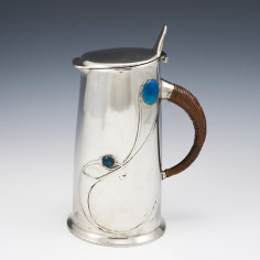 A Tudric Pewter Enamelled Jug and Cover Designed By Archibald Knox