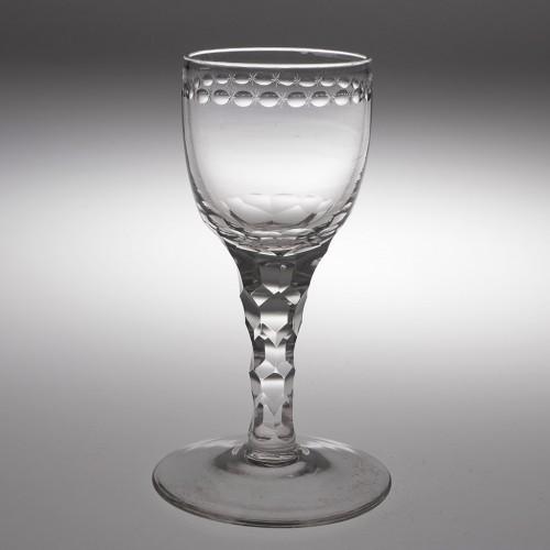 A Fine OXO Engraved Facet Cut Stem Wine Glass c1780