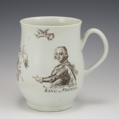 A Worcester First Period Porcelain 'King of Prussia' Bell Shape Mug 1757