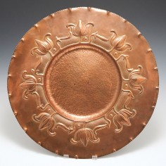 An Arts and Crafts Copper Charger c1905