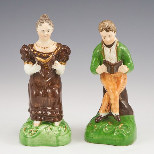 A Pair of Staffordshire Porcelain Figures of a Youth and Young Woman Reading c1835