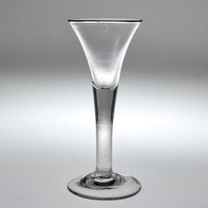 A Georgian Drawn Trumpet Plain Stem Wine Glass c1750
