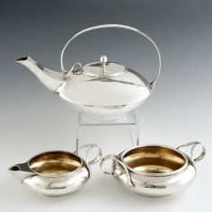 Three Piece Silver Tea Set Designed By Archibald Knox for Liberty 1905/06