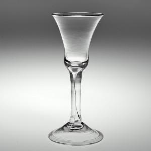 An Elegant Georgian Plain Stem Wine Glass with Extended Air Tear c1750