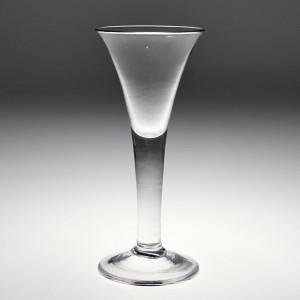 A Tall Drawn Trumpet Plain Stem Wine Glass c1750