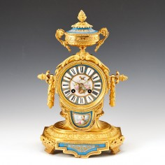 A French Porcelain Mounted Ormolu Mantel Clock Dated 1875