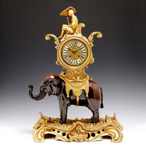 French Mantel Clock of Elephantine form on a Rococo base c 1870