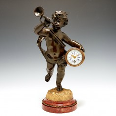 A French Bronze, Ormolu And Marble Mantle Clock c1900