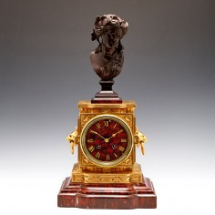 A French Bronze, Ormolu And Red Marble Mantel Clock c1880